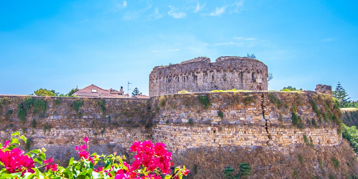 Chios castle, purple flowers, stone fortress, Chios