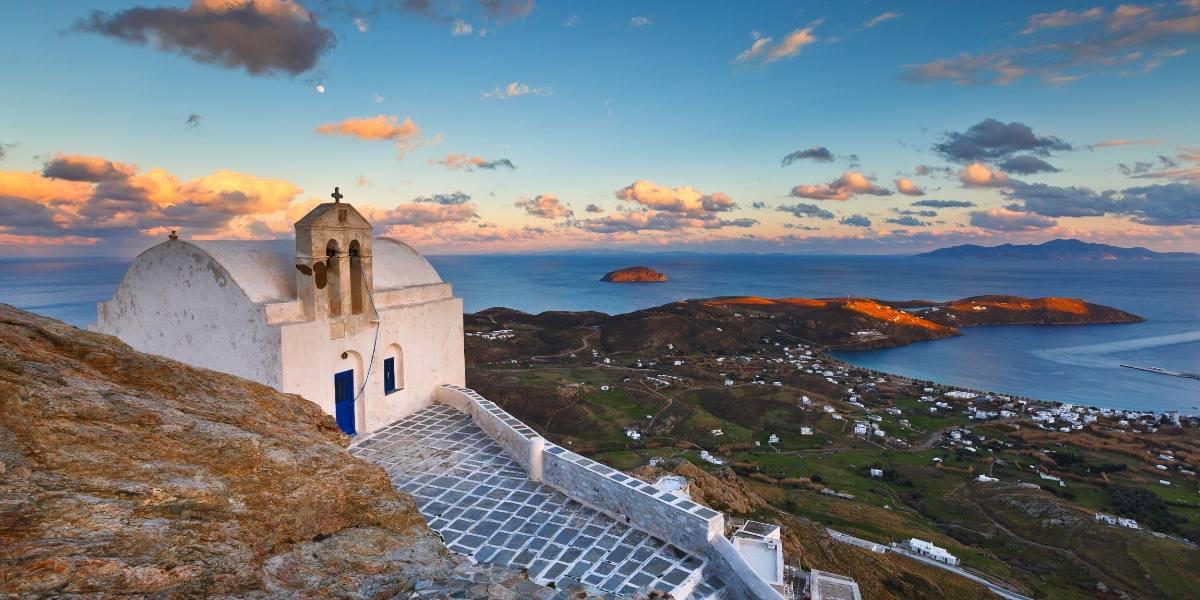white church, stone courtyard, rock, view of Serifos, nature, sea