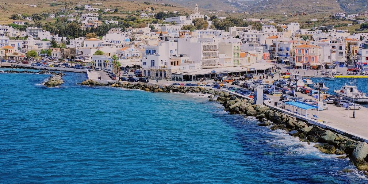 the port in Syros, blue waters, dock, cars, buildings