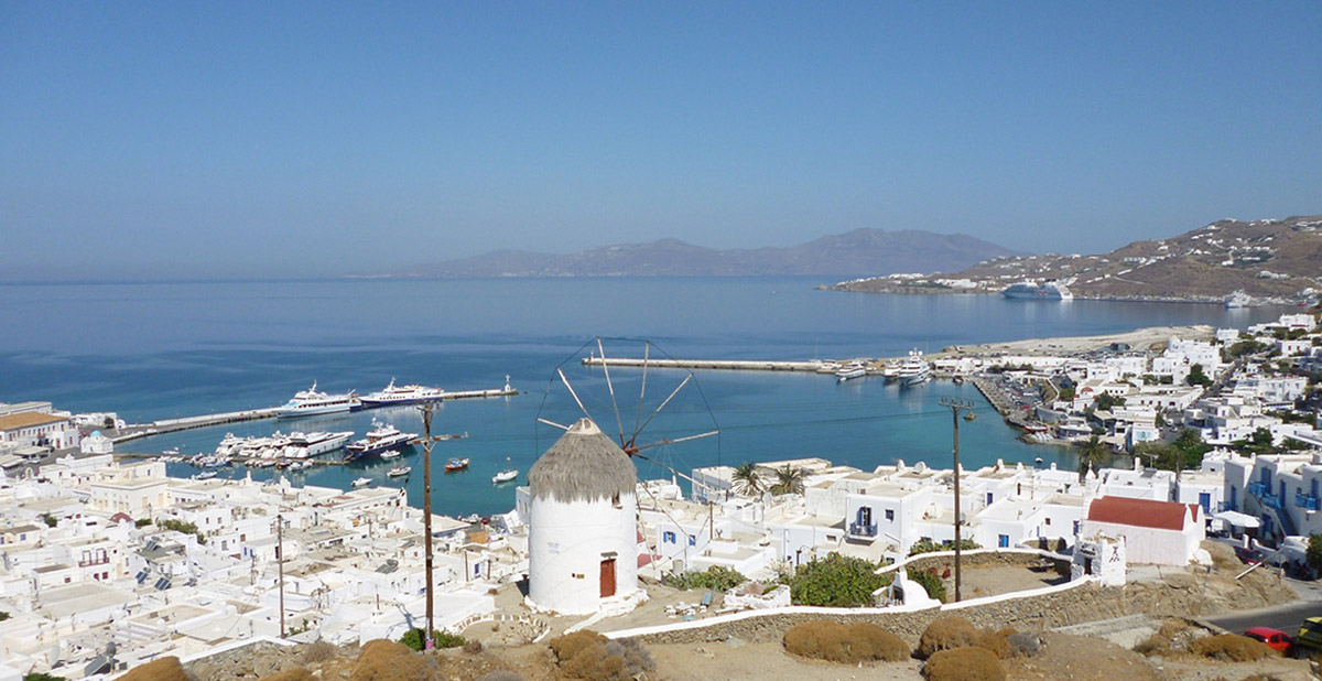 the town of Mykonos, windmill, white buildings, port, sea