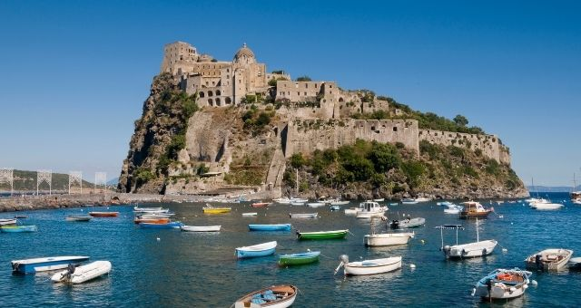 Ischia Castle and fishing boats