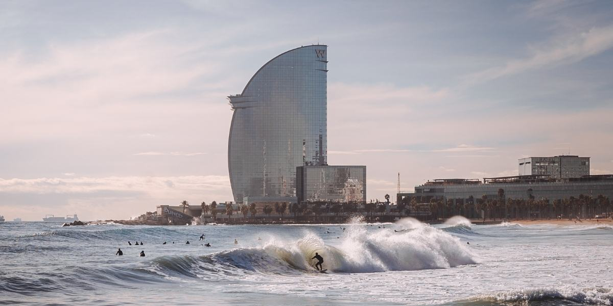 Surfing at the beach of Barcelona