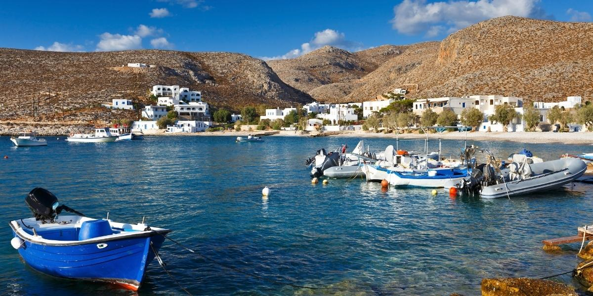 Fishing boats at Karavostasi, the port of Folegandros, white and blue houses, remote island, architecture