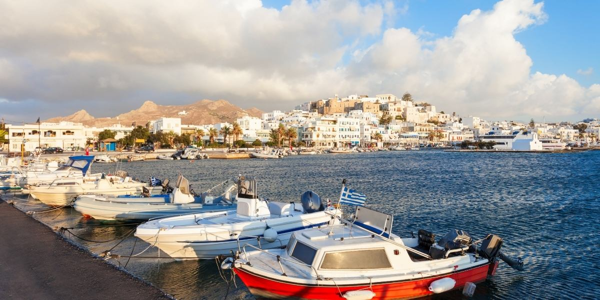 Fishing boats at the port of Naxos, bay, island town, castle, hill, ferries
