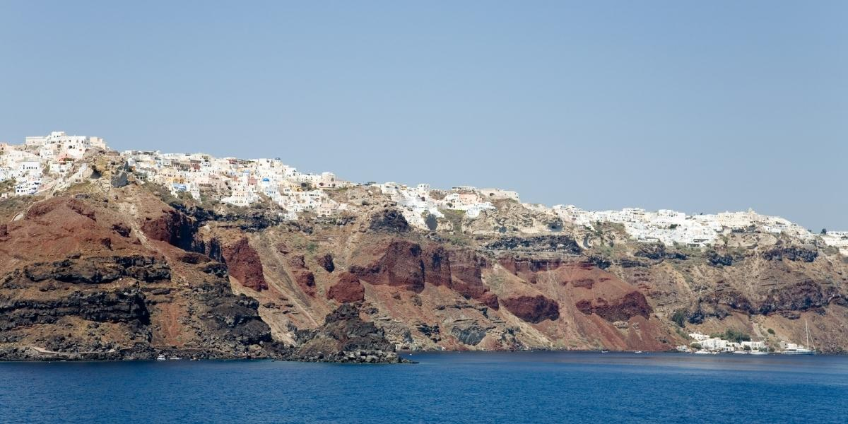 Santorini village, volcanic rock, white houses, sea, view from ferry