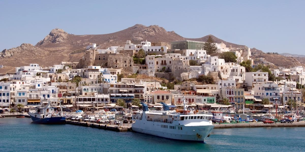 Skopelitis ferry at the port of Naxos, castle and town walls, houses, cars, boats