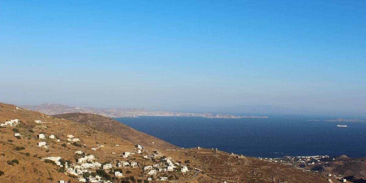 The island of Tinos, houses, hills, blue sea, ferry departure, Aegean islands