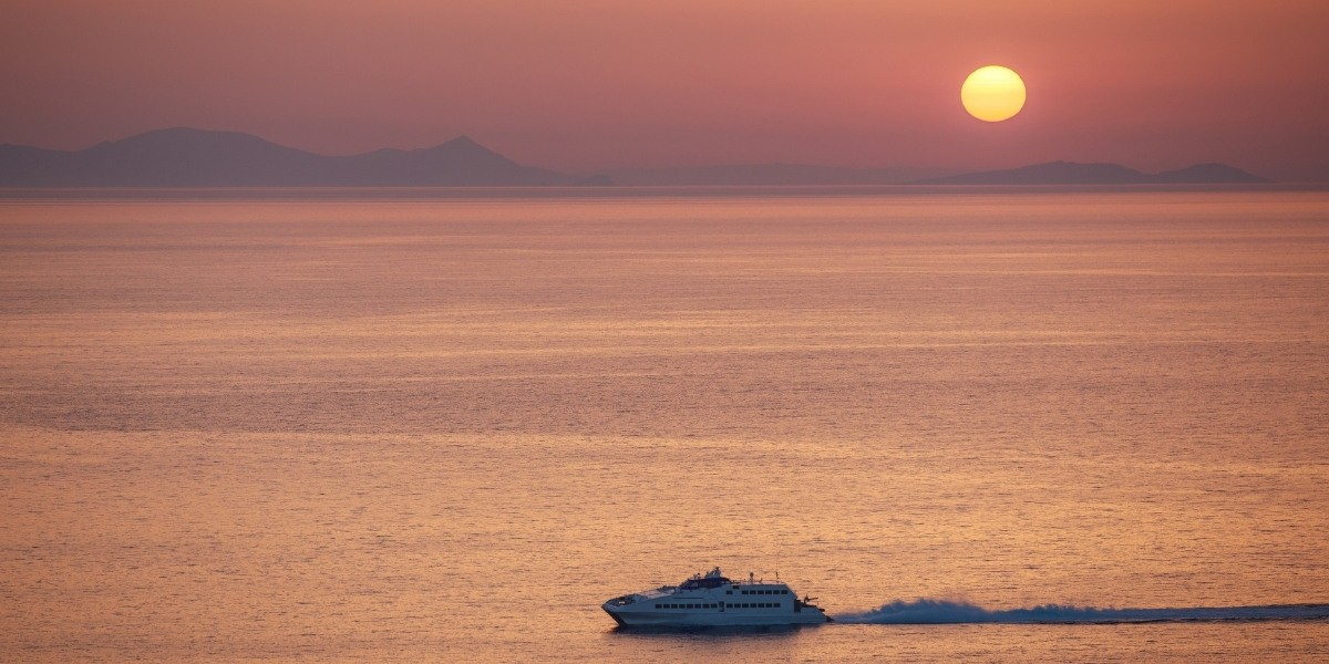 Ferry departing from Santorini at sunset