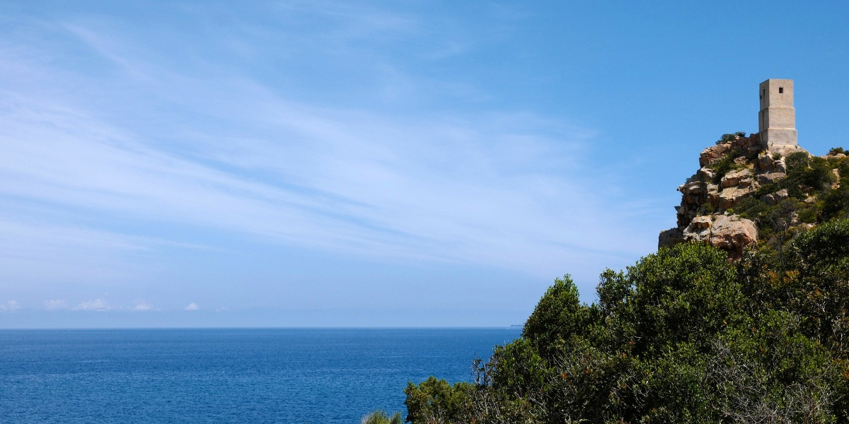 Blue sky,  lighthouse, cliff, sea view, Porto Torres, holidays in Sardinia, ferry routes from Rome, Italy