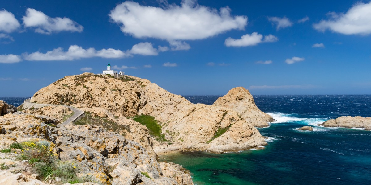 Lighthouse near the port of Olbia, nature and sea in Sardinia, ferry routes and tickets