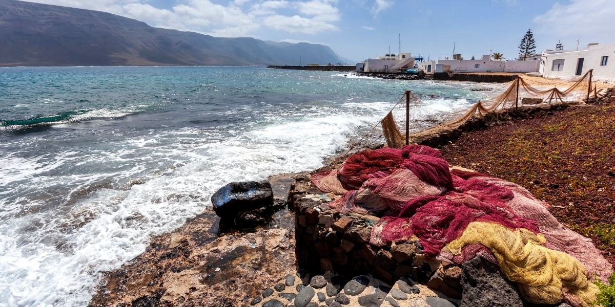 la graciosa, canary island, caleta de sebo, coastal village, fishing nets, rocky shore, houses