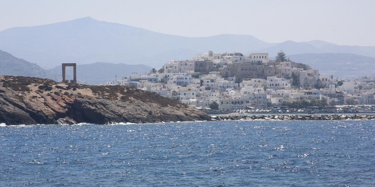 Portara archaeological sites, the town and castle of Naxos as seen from the ferry arriving at the island