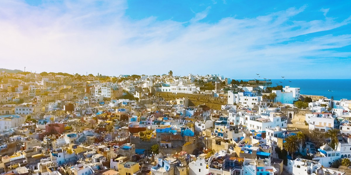 Sunny day in the city of Tangier, Morocco, colourful buildings, view of the sea, ferry routes from the spanish coast