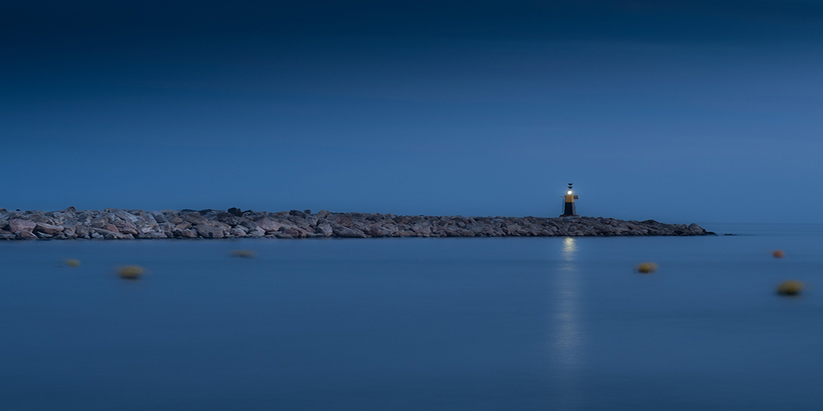 Lighthouse in evening blue, calmness, harbour in Motril, Andalusia, ferry routes from Melilla, Al Hoceima, Nador