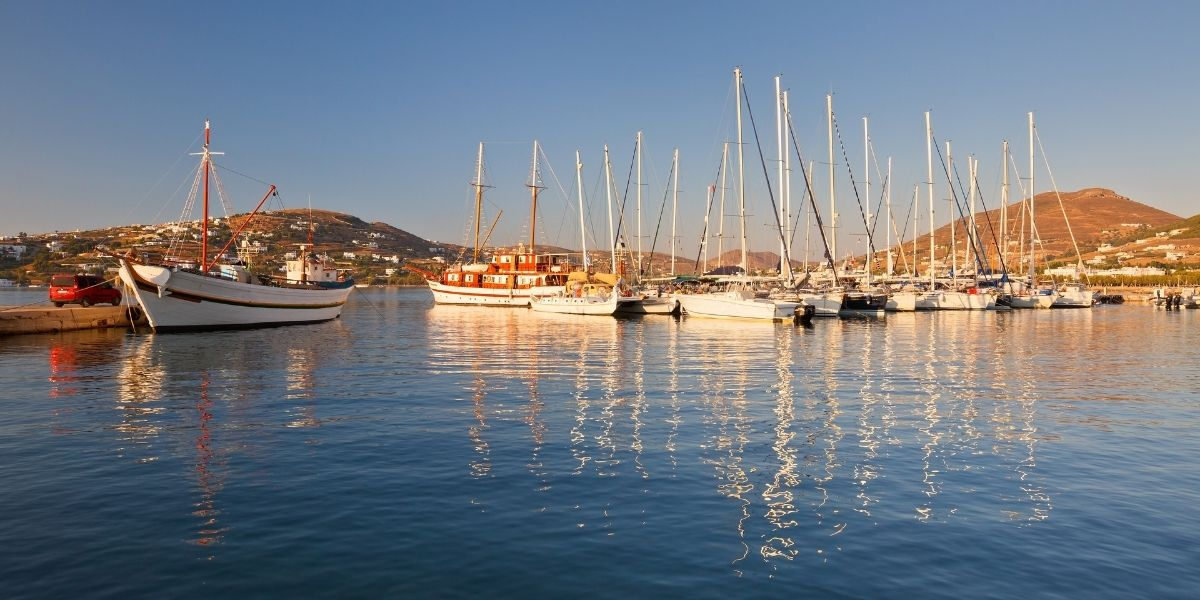 Sailing boats, fishing boat, red van, sea reflection, Paros port, Paroikia, sunset hour