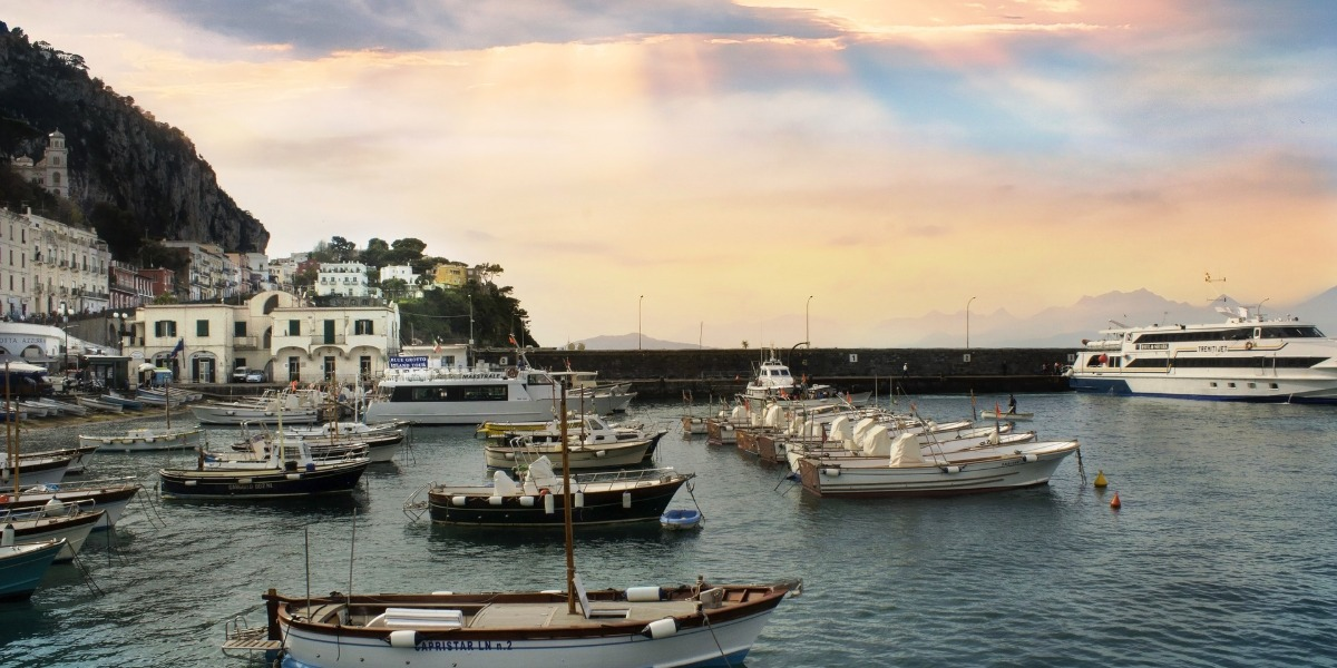 sunset over the port of Capri, the Amalfi Coast, routes and ferry tickets