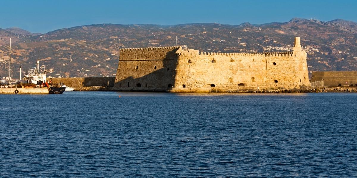 Fortress at the old port of Heraklion, mountains, city, waves, sea
