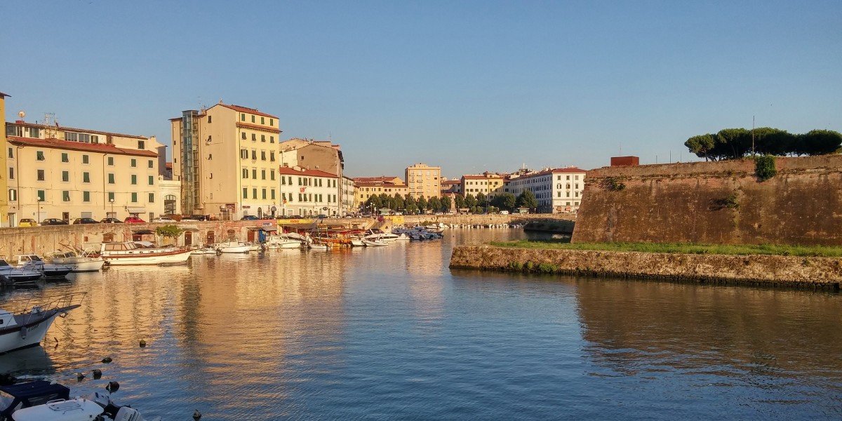 Sunset time in Livorno, Tuscany, architecture and light, holidays and ferry routes