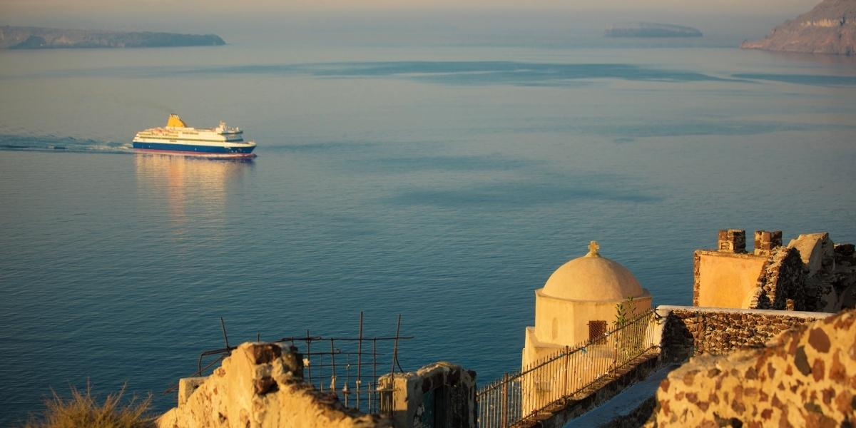 Ferry arriving in Santorini, sea view, church, houses, village