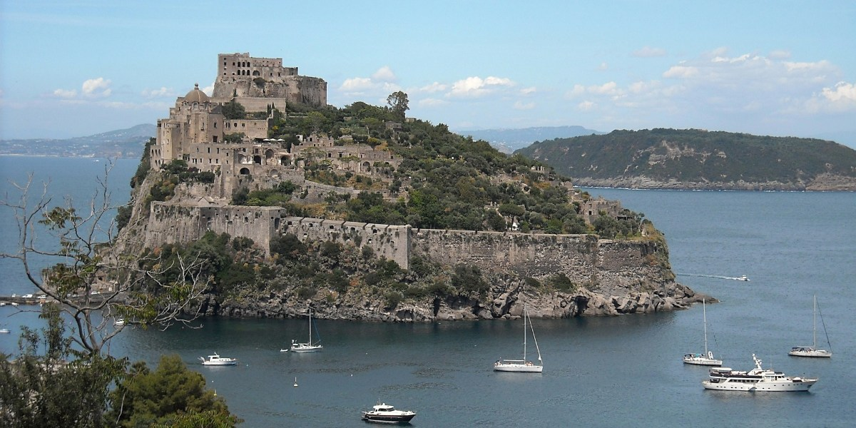The island of Ischia, sailing boats,  port of Positano on Amalfi coast, blue sea and nature, ferry tickets