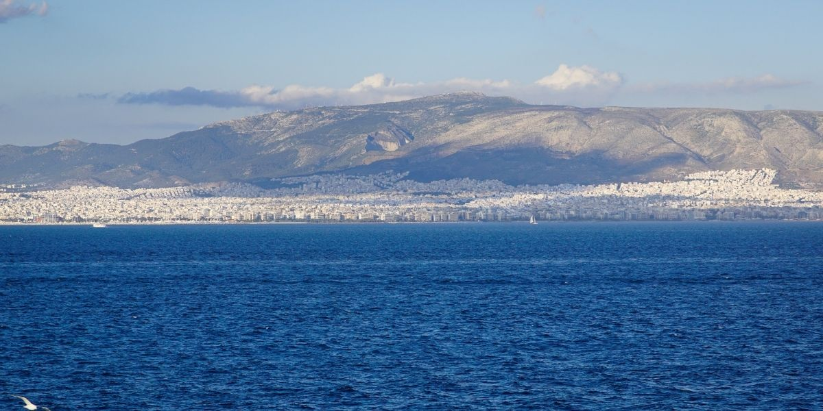 The city of Athens as seen from the ferry to Piraeus, houses, buildings and mountain