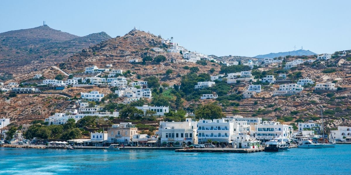 Ferry departure from the port of Ios, Cyclades, white houses, hill, island, blue sea