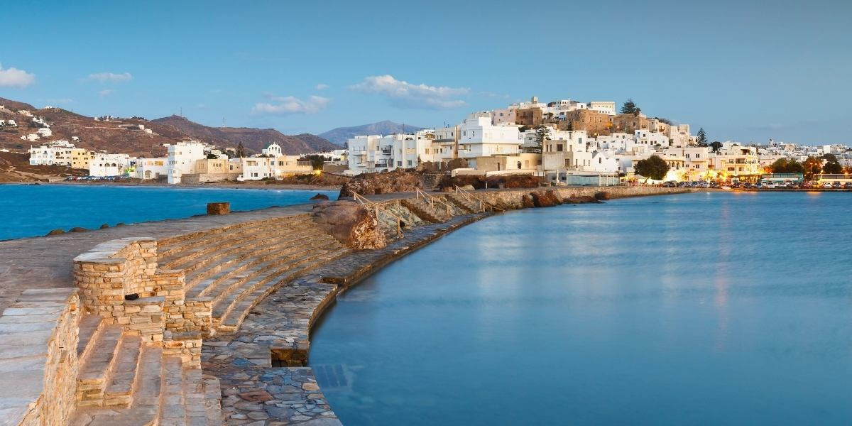 The port of Naxos, stairs, wave-breaker, blue sky, white houses, castle, island