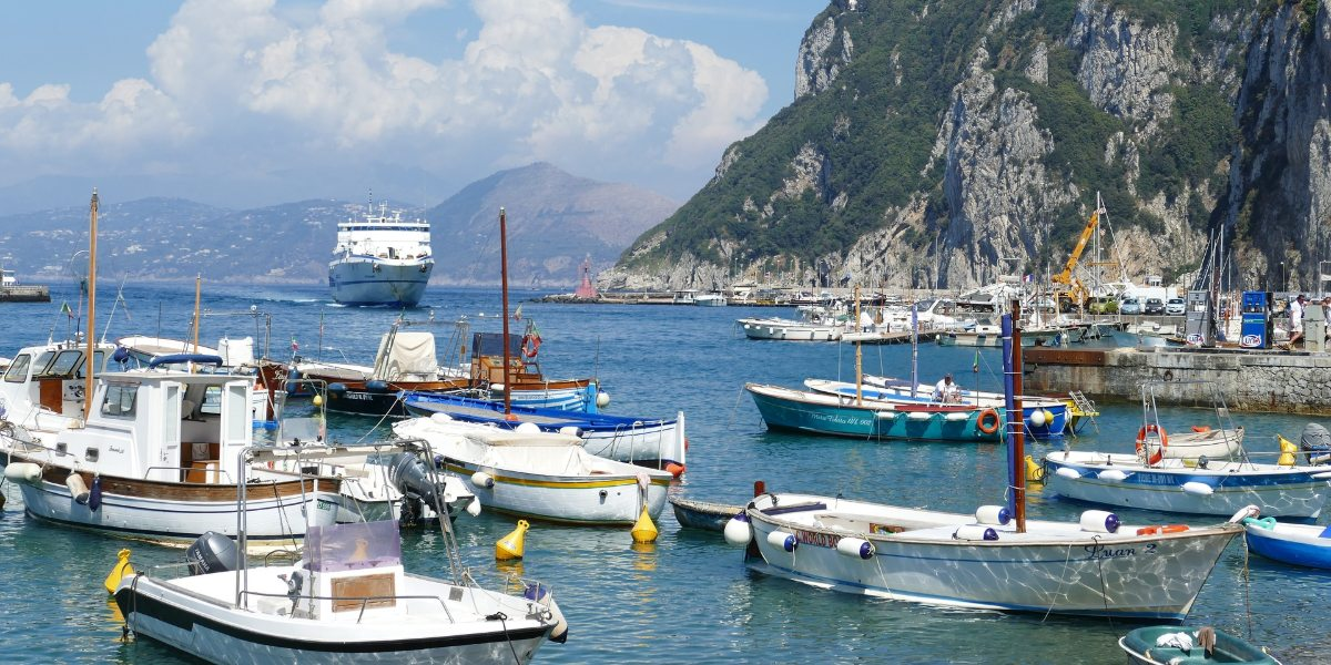 Port of Capri, blue sea, ferries and fish boats, Sorrento, Italy, ferry tickets