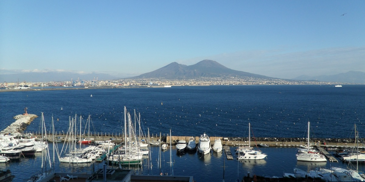 View of the port of Naples, Vesuvius volcano, sailing boats, Sorrento, ferry tickets
