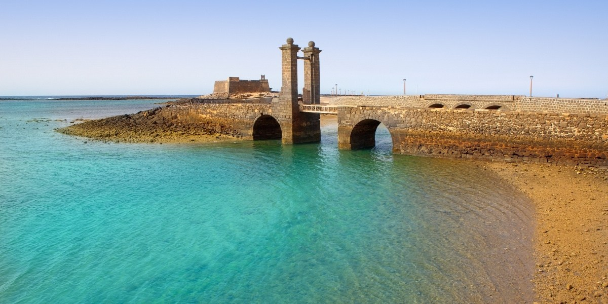 lanzarote, arrecife, stone bridge, crytsal-clear waters, old harbor, quiet beach, canary islands