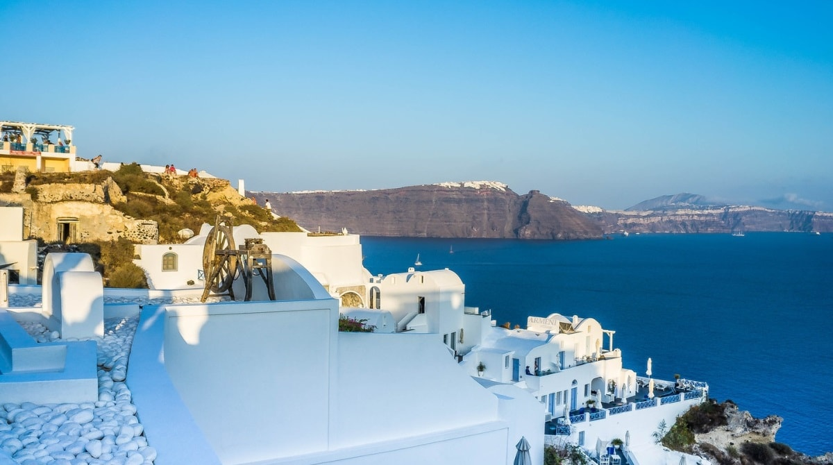 The village of Oia in Santorini, white houses, sea view, volcanic landscape