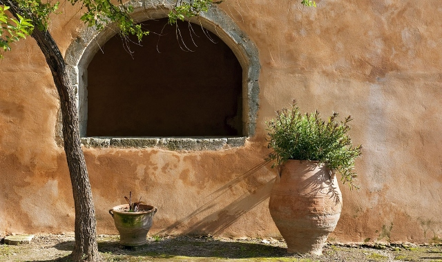 Detail from the old city of Rethymno, plants, wall, traditional style, small street