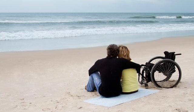 Couple at a beach in Spain using a wheelchair