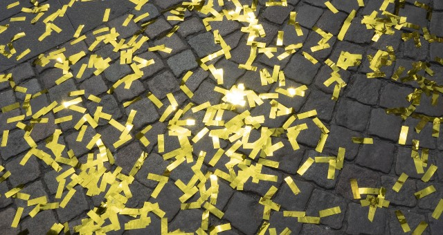 gold confetti on street, ferry tickets to Canary islands, parade in Santa Cruz de Tenerife