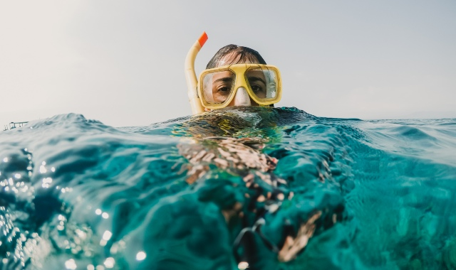 Child with sea mask, snorkeling
