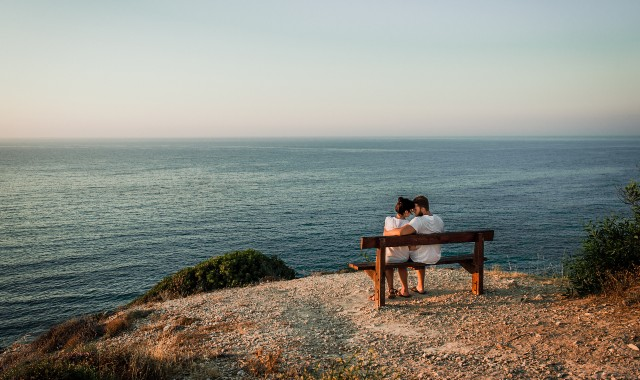 Couple enjoying a romantic view in the Cyclades