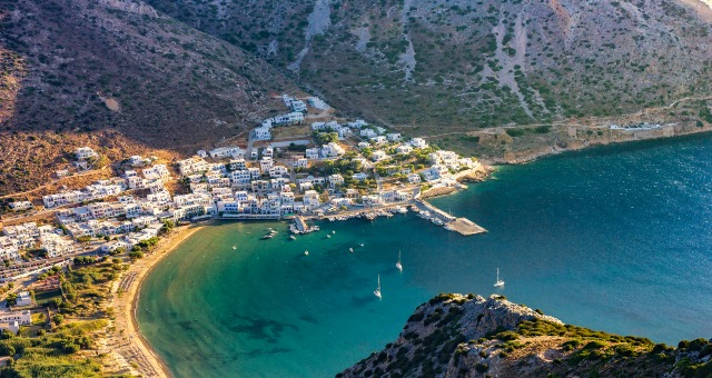 The port of Kamares in Sifnos, white houses, blue sea, Cyclades, island, sailing boats, landscape