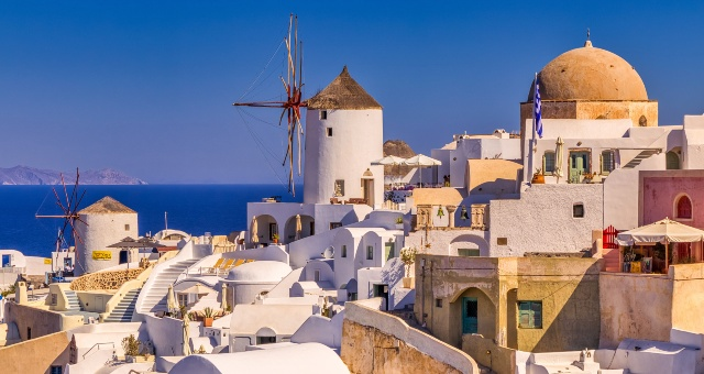 Oia village, Santorini, windmill, church, houses, small streets, sea view, horizon, blue sky