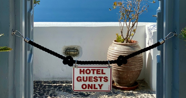 Sign in Santorini guest, no entry, hotel guests allowed, view, sea, flower pot