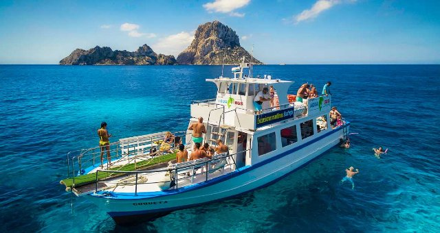 aquabus ferry, from ibiza to fomentera, people swimming in crystal waters