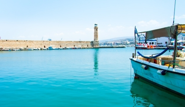 The promenade and old harbor of Rethymno with the stone lighthouse