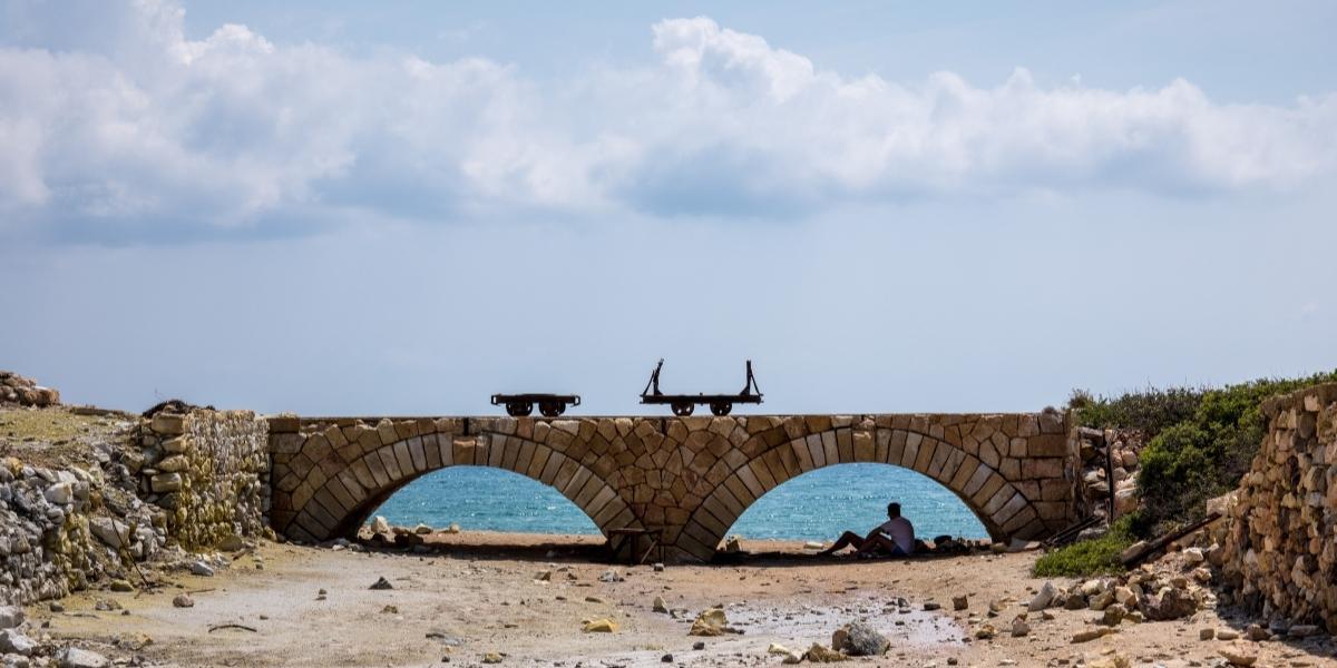 Little stone bridge at a beach of Milos