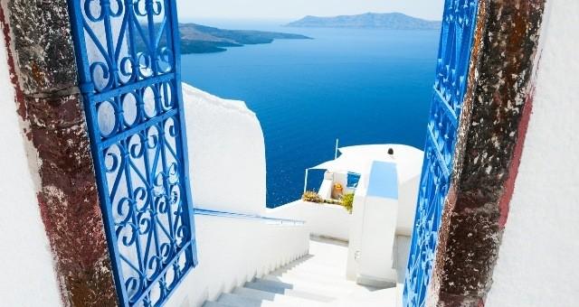 White terrace with blue door in Santorini