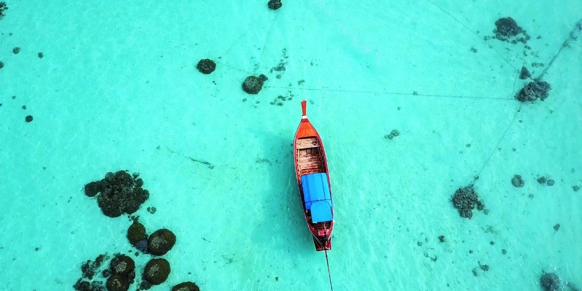 Boat on clear waters