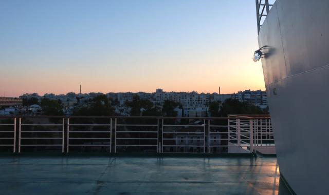 sunset on deck, ferry handrail, Kimolos