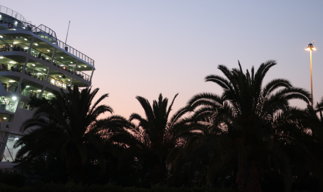 sunset, palm trees, evening ferry to Milos
