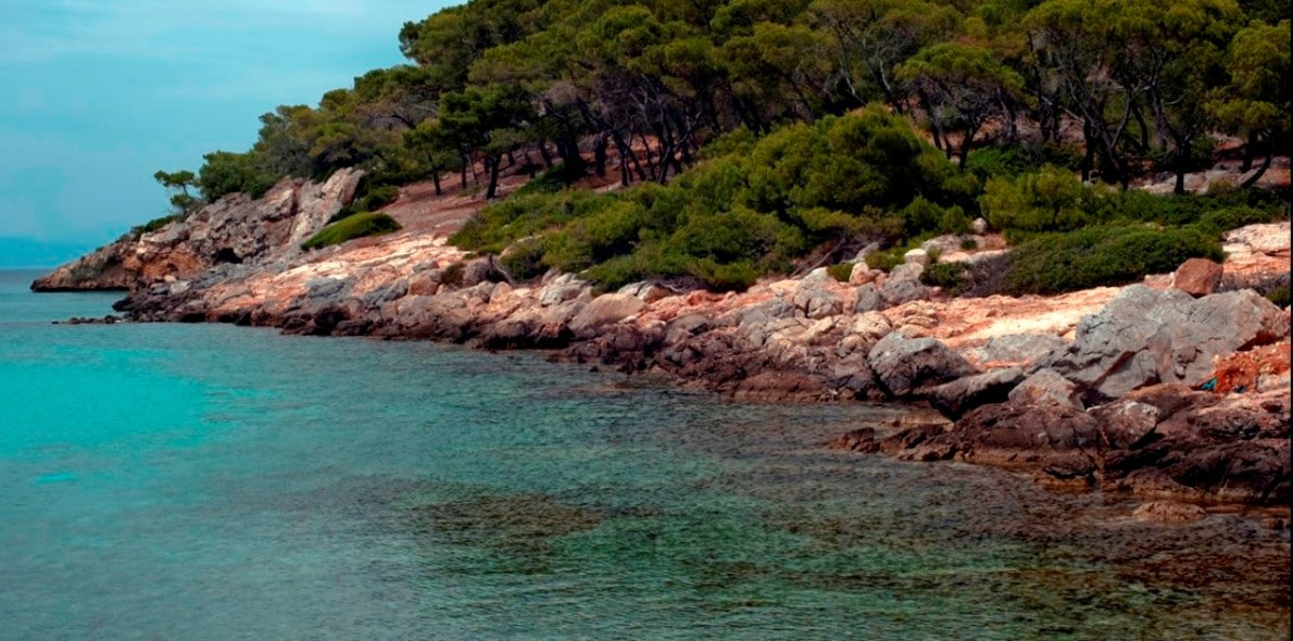 Detail from the beach of Dragonera in Agistri, crystal sea, ferry routes Aegina, Saronic islands