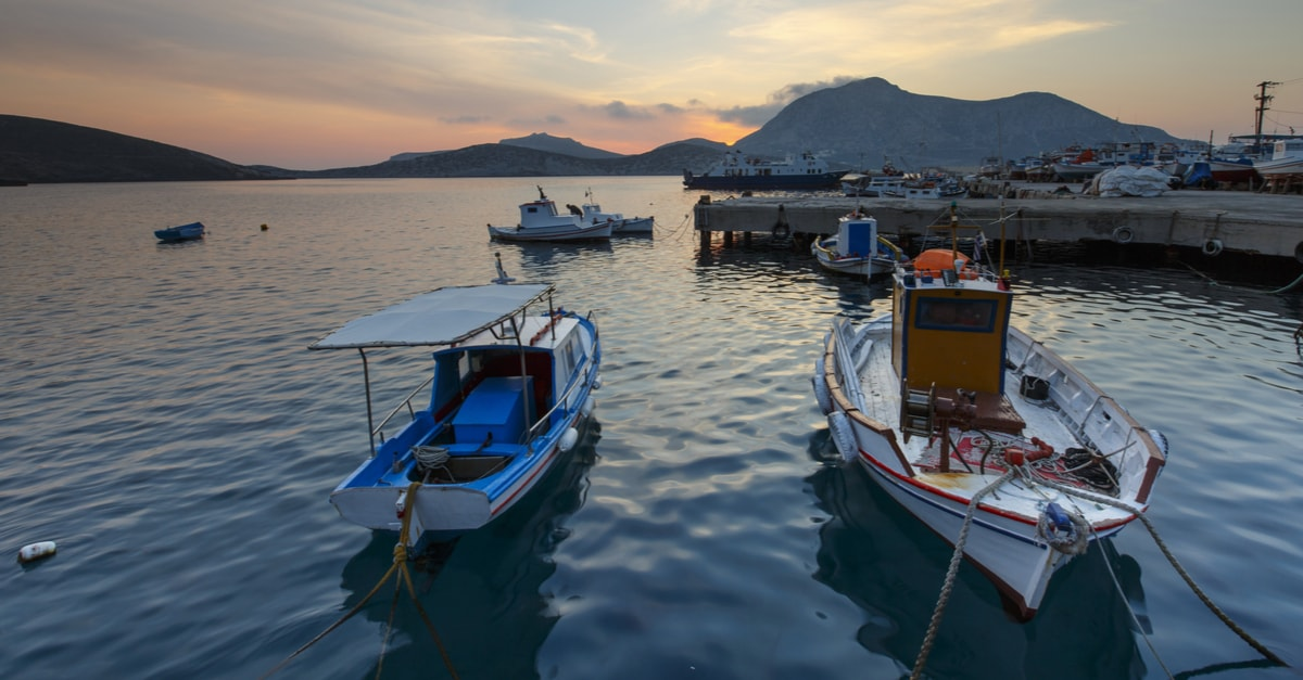 Two small boats in the port of Fourni island