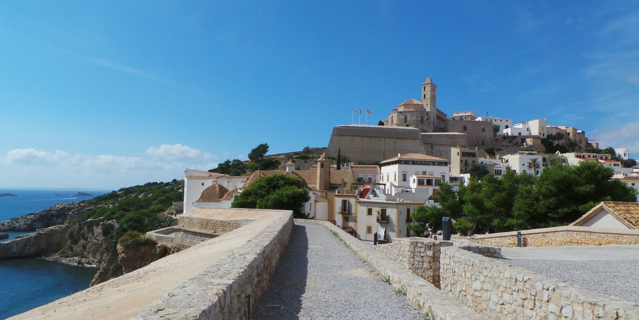 The walls of the old town of Ibiza, view of the Balearic sea, architecture, houses, heritage