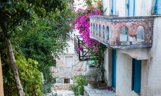 Picturesque alley, flowers, balcony, trees, traditional houses, Alonissos island holidays, ferry routes and tickets
